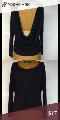Open back high low black top Very soft black top -- black is not faded - top is long sleeve- front is lower than back - arm pit to arm pit 20 inches -front of top laid flat is 15 inches. 100% rayon. Express Tops