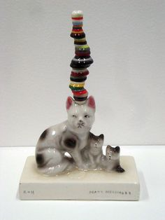 Untitled (Cat) (2011) by artist Matt Messinger. Found ceramic, buttons, resin. via the great god pan is dead
