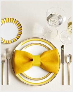 This bow tie napkin fold will add a fun pop to your table decor. Fold your napkin so the two halves meet in the middle. Fold it again, the same way as before, making a long strip. Fold the ends…Read more › Bow Tie Napkins, Folding Napkins, Linen Napkins, Cloth Napkins, How To Fold Napkins, Paper Napkin Folding, Place Settings, Table Settings
