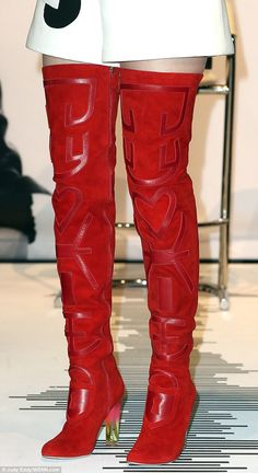 Legs get going! The striking red boots were made of suede decorated with glossy insets...