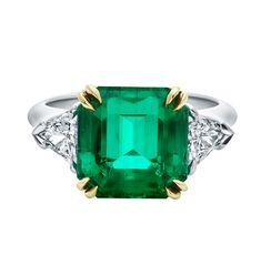 Classic Winston™, Emerald-Cut Emerald Ring An emerald-cut emerald, 5.09 carats, set as a ring with trilliant-shaped diamond side stones weig...