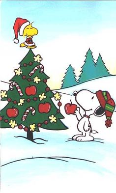 woodstock and snoopy decorating their christmas tree next year i plan on having charlie brown christmas tree it is simple and easy to take down after