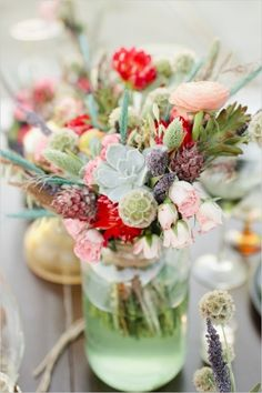 bridal bouquet turned into a part of the centerpiece #desertwedding #southwestwedding #weddingchicks http://www.weddingchicks.com/2014/01/01/vibrant-desert-wedding-inspiration/