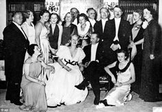 Relationship: Hitler (standing third from right) and va Braun (kneeling far right). His butler said 'Hitler and Eva were very much in love, but perhaps not to the extent that he ever wanted children with her'