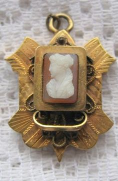 Antique Cameo Brooch. I believe I might have this pendant & matching earrings, too- from my Grandmother Nancy.