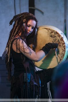 (Celtic Bodhrán Drum.) This woman looks at peace with herself, she does not care what society thinks of her and that is freedom.
