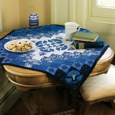 Heavenly Blues Quilt Pattern - Great looking table topper or wall hanging!  http://quiltwoman.com/Heavenly-Blues-Quilt-Pattern.aspx