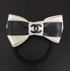 Chanel Bow Hair Tie. LEATHER, VIP Gift. Hand Made. Get the lowest price on Chanel Bow Hair Tie. LEATHER, VIP Gift. Hand Made and other fabulous designer clothing and accessories! Shop Tradesy now