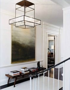 Today's favorite entry - love the mix of styles, especially the artwork, ceiling fixture, dark floors, bench, area rug, + molding