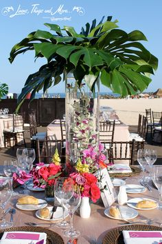 High end wedding decor and floral design at the Hilton Los Cabos. Thank you Cabo Floral Studio, great palm tree centerpieces!