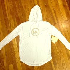 Michael Kors Long Sleeve Top Size XS White MK too with gold stud logo. Size XS, new with tags Michael Kors Tops Tees - Long Sleeve