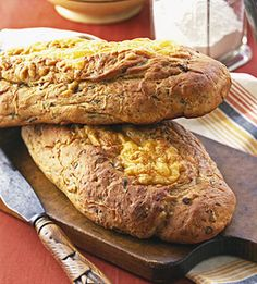 Beer Bread    Sausage, beer and cheddar cheese mix it up in these hearty loaves. They're sure to be a hit with the football crowd whether you're tailgating or hosting a Super Bowl party.