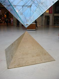 Brilliant counterpoint, heightened visual emphasis. Detail of inverted glass pyramid inside the Louvre Museum - Paris, created by I. M. Pei.
