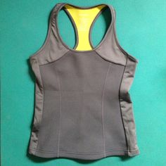 Gray zaggora hot top Neoprene material workout top that's specifically designed to help you burn more calories when you work out. I have the same one in black and I don't really need two of them. They're pretty cool, try it out! This is my lowest unless bundled! Zaggora Tops Tank Tops