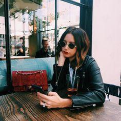 Ashley Tisdale in a break from work in her trendy black leather jacket by Linea Pelle