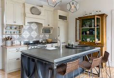 The 72-by-46-inch island, topped in luxurious (lead-free) pewter, is a workhorse. In addition to housing the large farmhouse sink, a pair of dishwasher drawers and the pullout trash, it offers handy counter seating.