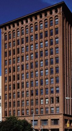 Prudential (Guaranty) Building, Buffalo, New York, 1894-95, by Louis Sullivan and Dankmar Adler.  Completed in 1895, this Prudential office building is divided into three design zones: the wide-windowed ground-level shops; the main office block, with vertical ribbons of masonry rising across upper floors and an ornamented cornice at the roof level decorated by round windows and Art Nouveau vines.