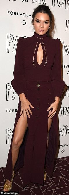 Catwalk star: Model Kendall rocked a burgundy gown with two thigh-high splits and a key-ho...