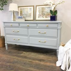 Grey lacquer dresser with gold hardware