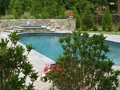 Outdoor Spa and Swimming Pool with Flagstone Pool Deck