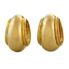 """Tiffany & Co. Paloma Picasso Gold Hoop Earrings. Chunky tapering hoop earrings with banded edges, in polished 18k yellow gold, with posts for pierced ears, circa 1980's, signed Paloma Picasso/Tiffany & Co. 0.75"""" length."""