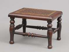 """Oak miniature apprentice foot stool with caned top, turned H-shaped stretcher and legs.      English Circa 1870     Height: 6"""" 