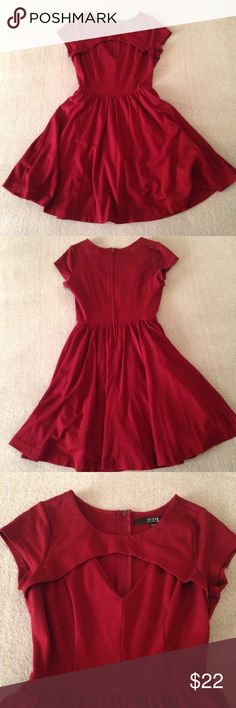 Burgundy Guess Dress Adorable little burgundy dress with a triangle cutout in the front. Zips up on the back and has a built in underskirt. Guess Dresses Midi