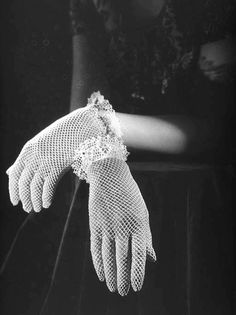 Hands in lace gloves, 1940s (Clifton Firth)