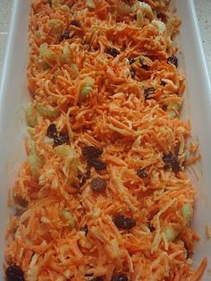OLD FASHIONED CARROT SALAD:   1 Granny Smith apple,  5-8 med carrots,  1-2 stalks celery,  ¼ C mayonnaise,  juice of one lemon,  ¼ C raisins,  salt & pepper to taste