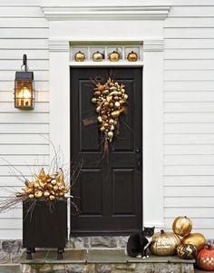 gilded pumpkins on doorstep via @Country Living Magazine