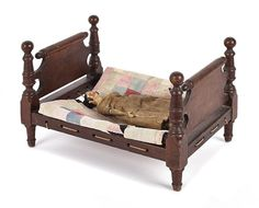 """Tiger maple doll's bed, 19th c., 8 3/4 h., 9 1/2w, 13 1/2"""" d, Pook & Pook, Live Auctioneers"""