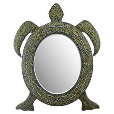With a sea turtle-inspired design, this artful wall mirror is perfect for coastal-themed spaces or your child's room. Product: Wal...