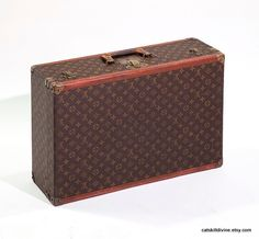 Vintage Louis Vuitton - had it, a few times, and sold them all. I don't use luggage without wheels anymore.