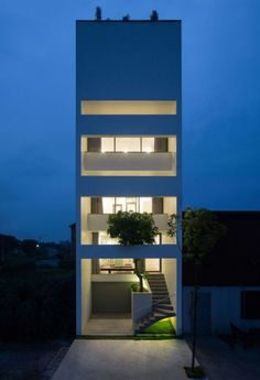 Trees grow up through this five-metre-wide house in Vietnam, designed by Nguyen Khac Phuoc Architects to offer residents respite from noise and smog Plans Architecture, Residential Architecture, Contemporary Architecture, Architecture Design, Architecture Supplies, Revival Architecture, Architecture Wallpaper, Minimalist Architecture, Narrow House Designs