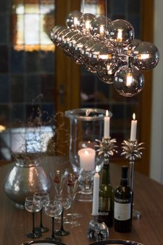 Long hanging lamp in amber consists of 24 glass balls gives a perfect light to dining tables. Splendor Bar by Rydens. Scandinavian Ceiling Lighting, Ceiling Lamps, Glass Ball, Dining Tables, Balls, Amber, Chrome, Bronze, Lighting