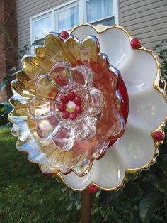 This is a garden flower ornament designed to be hung from a stake in your yard. It has been hand crafted, from vintage bowls and plates that had a former purpose. A unique grouping of vintage glass plates and bowls, up-cycled or repurposed to make something new, a work of art. Bonded together permanently with the finest glass bonding adhesive, they DO NOT come apart! Take a look at all photos I have displayed to see every angle to get a good idea what it will look like. I have used four…