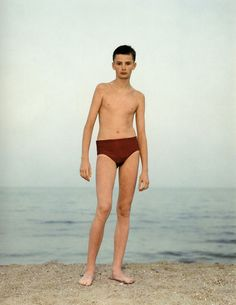 RINEKE DIJKSTRA - In this series, Dijkstra explored Teanagers who were in the transition between Childhood and Adulthood.  She was interested in the awkwardness of people at this age.   She photographed them on beaches, all the images are taken in a similar way.