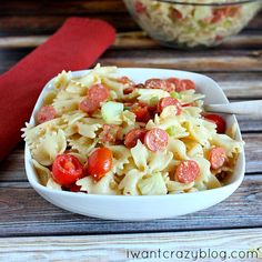 The BEST Pasta Salad EVER! Not soggy or drowned in mayo. FRESH & FLAVORFUL. Tons of pepperoni and crunchy veggies, you will never look at pasta salad the same! #pastasalad #pepperoni