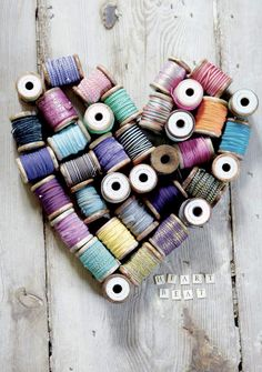 great use for all the spools of thread I find! Cute wall decor for my sewing/craft room!