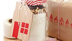 Courtesy of Lowe's, the perfect Christmas gift for your neighbors!  Add your favorite cookie recipe ingredients to a mason jar and top it off with a house shaped gift tag made out of wood veneer. Instructions here.