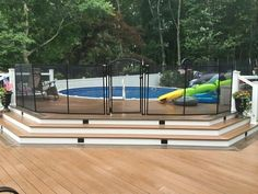 above ground pool with deck and safety fence