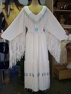 White deer/elk hide wedding dress with seed bead detail around the neck, glass crow beads and tin cones and the belt has a custom made seed beaded rosette.. http://nativeamericanstuff.net/Native%20American%20Style%20Crafted%20Clothing%20buckskins%20outfits%20moccasins%20and%20Handbags.htm