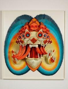 L'artiste AJ Fosik, basé à Portland dans l'Oregon, présente à l'occasion d'une exposition intitulée Against the Infinite, ses oeuvres tridimensionnelles.  Ses illustrations en bois sont un mélange entre tableau et sculpture. L'artiste utilise un spectre lumineux et coloré pour chacune de ses pièces, exagérant leur nature animée. Les travaux sculpturaux ont un attrait étrange du à l'exploration des thèmes de la mort, de l'idolâtrie et de la dualité entre physique et symbolique.