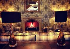 Cosy up to the warm fire in The Drawing Room
