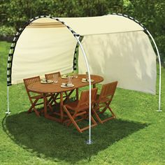 The Suntracking Shelter - Hammacher Schlemmer - site has a lot of cool stuff (costly) but so much can be easily made, like this... pick an outdoor fabric... some PVC pipe... I would probably make with elastic straps... a moveable shade over your picnic area!