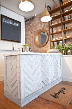 One of my favourite parts of this renovation is the front counter. Renovare was able to quickly order the beautiful statturo marble and install it in the nick of time. I decided to reface the existing front counter as well as new front counter in a herringbone pattern. We created this with pine wood that was cut to fit and had Mango Reclaimed paint the wood in a custom finish