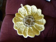 J hook; 100% cotton yarn. Rendition of Sunflower Dishcloth. Came out to measure 9 and 1/2 inches across.