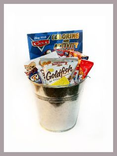Another idea I got from a great friend's wedding.  She had tin buckets for the kid quests at her wedding filled with an activity book, crayons, and snacks like goldfish crackers.  It was so cool!