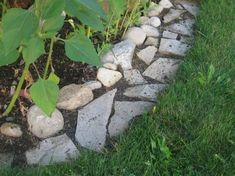 Make Mowing Easy with a Flagstone Edging Strip - it's fun and easy to build. Mowing strips are designed to allow your mower wheel to run along beside the garden, cutting to the edge of the grass neatly while not disturbing the flower bed. They're generally anywhere between 4 to 12″ wide and can be made from bricks, stone or gravel.