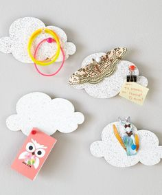 Shop Kids Decor: Mini Cloud Shaped Corkboard.  Some of us thought clouds were made of cotton candy.  Some of us thought they were made of water vapor.  It turns out they're made of cork.  But at least it makes them better to attach notes to.